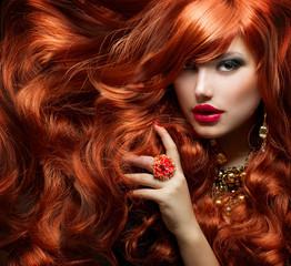 Fototapeta Do fryzjera Long Curly Red Hair. Fashion Woman Portrait