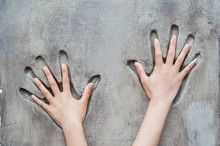 Handprint In The Wall