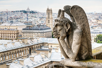 Chimera of the Cathedral of Notre Dame de Paris overlooking Pari