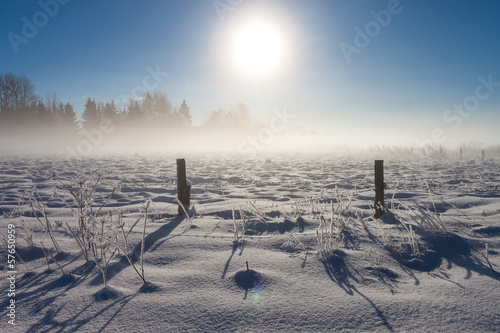 Wall Murals Northern Europe Barbed wire fence with snow covered ground