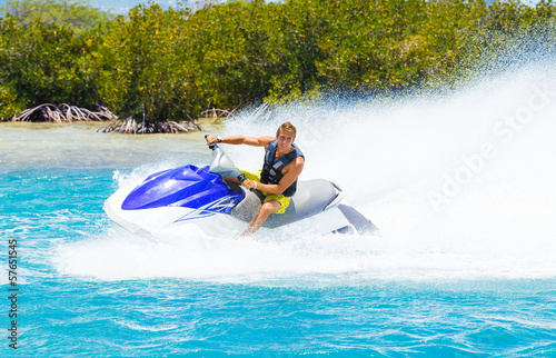 Photo Stands Water Motor sports Man on Jet Ski