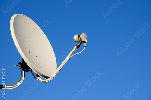 Fotografie, Tablou  Satellite TV antenna on blue sky background