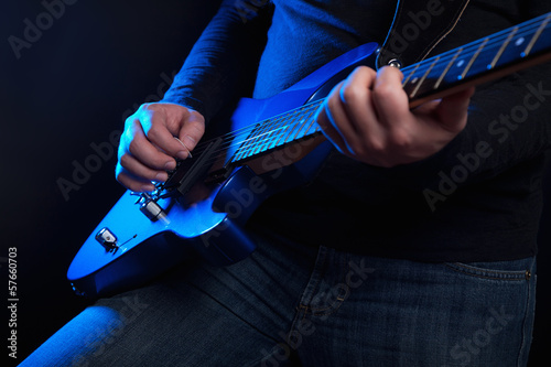 Photo  rock guitarist with blue guitar
