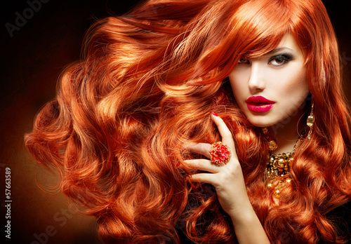 Photo Long Curly Red Hair. Fashion Woman Portrait