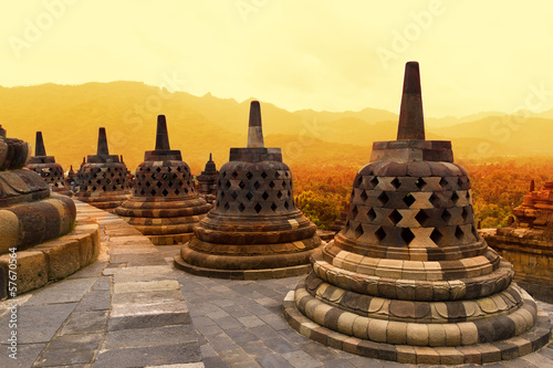 Montage in der Fensternische Indonesien Borobudur Temple at sunset. Ancient stupas of Borobudur Temple.