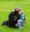 canvas print picture - girl hugging Newfoundland dog