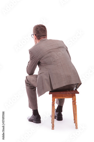 Fotografie, Obraz  back of a young business man sitting on a chair