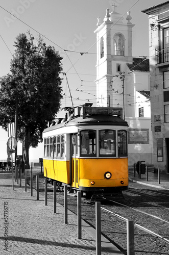 Fényképezés  Lisbon old yellow tram over black and white background