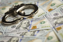 Handcuffs And Newly Designed One Hundred Dollar Bills