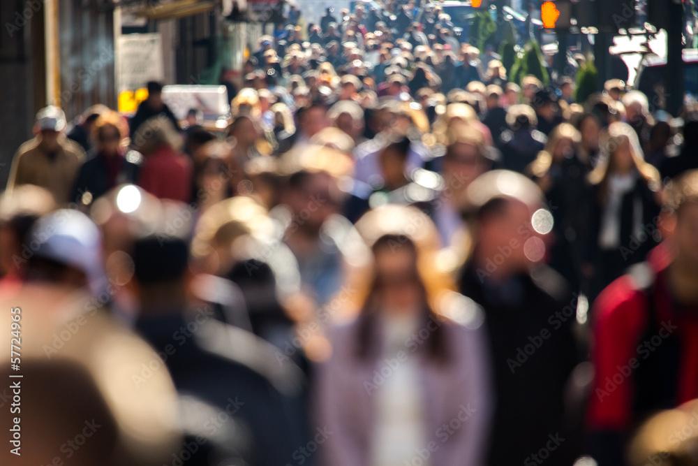 Fototapeta Anonymous crowd walking on a street in New York