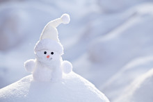 Little Funny White Snowman In The Snowbank.