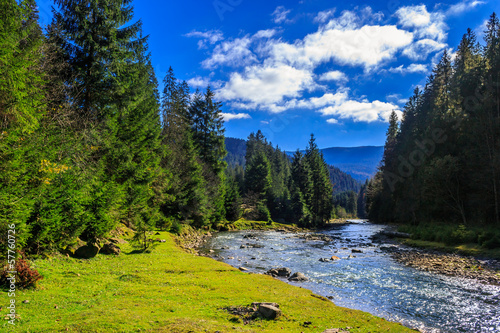 Printed kitchen splashbacks River river flows by rocky shore near the autumn mountain forest