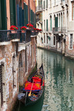 Backstreet canal Venice with empty gondola
