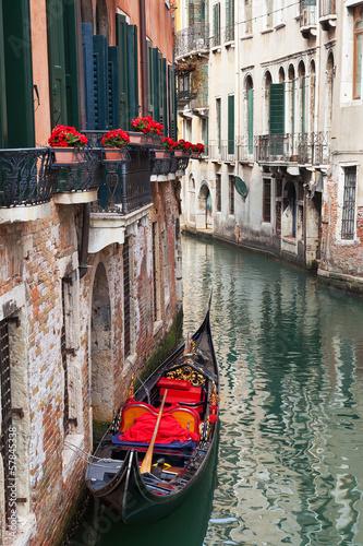 Backstreet canal Venice with empty gondola