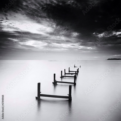 Foto op Canvas Zwart broken jetty