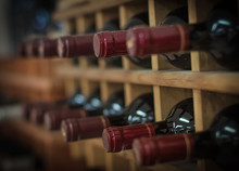 Red Wine Bottles Stacked On Wo...