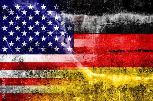 Fotografía  USA and Germany Flag painted on grunge wall