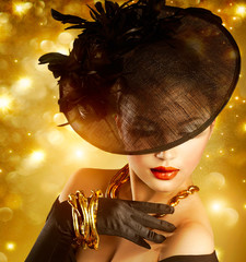 Glamour Woman Portrait over Holiday Golden Background