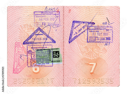 Opened Russian passport with stamps isolated on white with