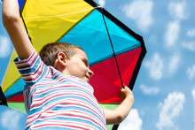 Little Boy Flies A Kite Into T...