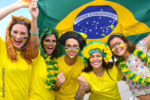 Photo  Group of happy brazilian soccer fans commemorating victory.