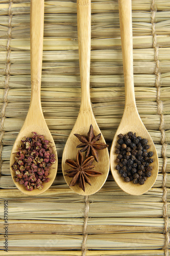 Fototapety, obrazy: Three spices in a wooden spoons on wooden board