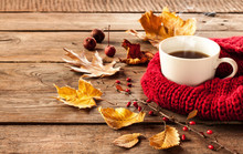 Hot Coffee And Autumn Leaves On Vintage Wood Background