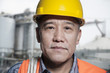 Portrait of proud worker in protective workwear outside of a factory