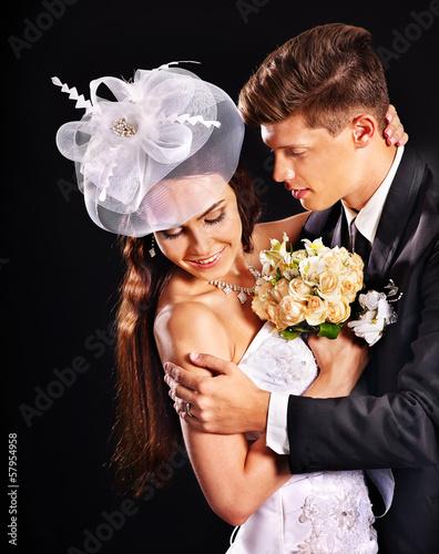 Groom embracing bride . Fototapete