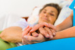 canvas print picture - Caring Nurse Holding Hands