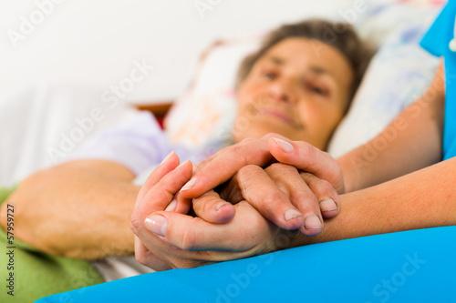 Fotografia  Caring Nurse Holding Hands