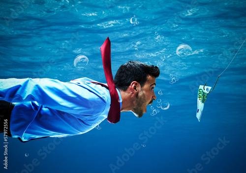 Businessman taking the bait Fototapeta