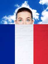 Woman Face Behind Wall With France Flag