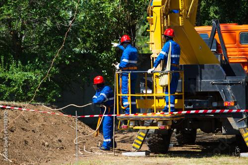 Fotografie, Obraz  Electrical workers. Repairing lines