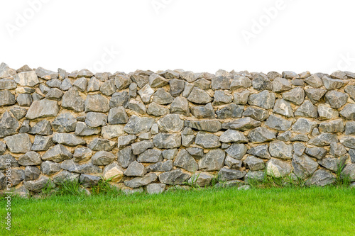 Cuadros en Lienzo fence real stone wall surface with cement on green grass field