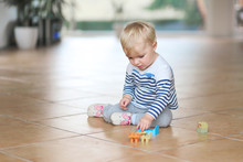Cute Little Baby Girl Play With Plastic Bricks