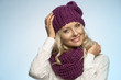 canvas print picture - young beautiful blond wearing scarf and winter hat