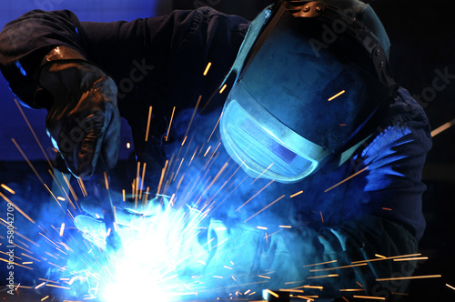 Fotografie, Obraz  worker while doing a welding with arc welder