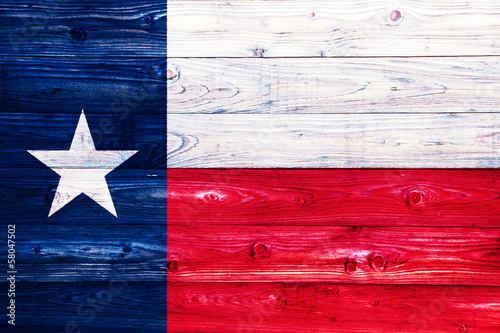 Fotografie, Obraz  Flag of Texas on wooden surface
