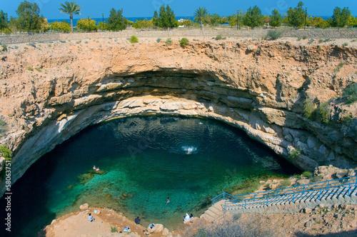 Fotografie, Obraz Bimmah Sinkhole in Hawiyat Najm Park, Sinkhole Park, Oman