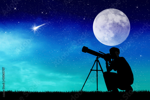 Man looks into the telescope Canvas Print