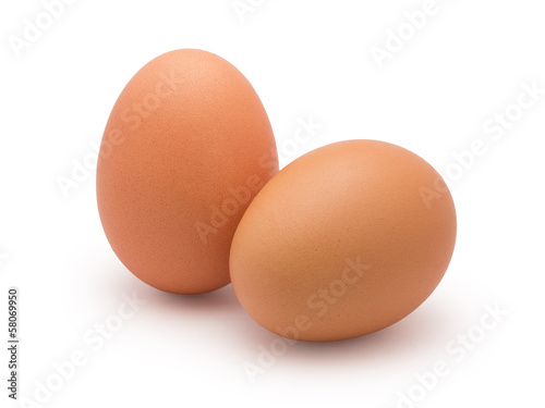 Photo two eggs isolated on white