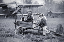 Young Aviators At The Airport With A Airplane