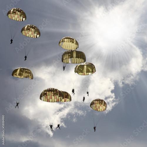 Fotografie, Obraz  The skydivers on stormy sky.