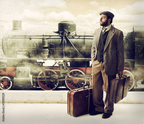 Photo Emigrant to the train station with cardboard suitcases