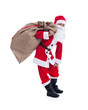 Santa carrying his large bag - isolated