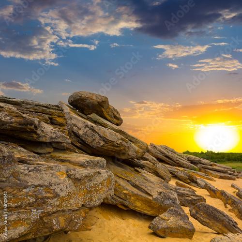 stony desert at the sunset - 58108142