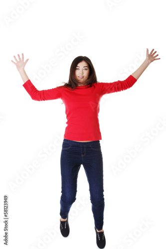Attractive woman with spread hands up.
