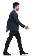Young Smiling Business Man Walking Forward