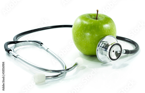 Láminas  protect your health with healthy nutrition.Stethoscope, apple